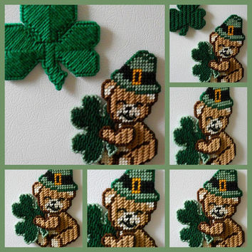 Cute Saint Patricks day bear magnet with a shamrock and a hat on made from plastic canvas and yarn in colors of green brown tan white black