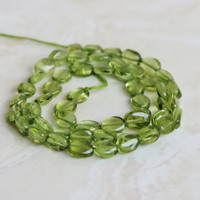 Peridot Gemstone Briolette Smooth Oval Nugget Center Drilled Green 6.5mm 24 beads