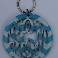 Adorable acrylic monogrammed keychains made in light blue and white chevron