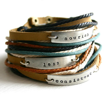 Bracelet. Leather wrap bracelet with multi-color cords and your word of the year, name, or date.