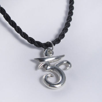 Om in sterling silver with hand-plaited cord