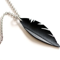 Medium rubber feather pendant upcycled from bicycle tire inner tube . Alternative black leather wing necklace with stainless steel chain