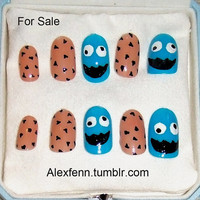 Cookie monster hand painted fake nails.