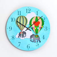 Children's clock, elephants lifted by hot air balloons. 10 inch wall clock. Blue sky background. CL3015