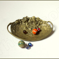Art nouveau bronze casted trinket tray. 1900s trinket dish with floral decoration.