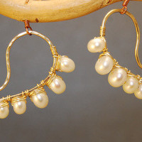 Cosmopolitan 46 Hammered swirl shapes wrapped with ivory pearls