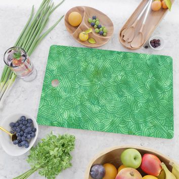 Bright green swirls doodles Cutting Board by savousepate