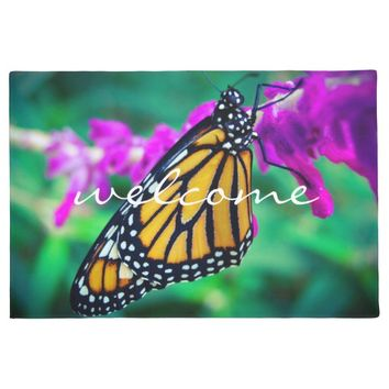 """Welcome"" orange monarch butterfly photo doormat"
