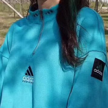 ADIDAS  A Half Zip movement Sweater