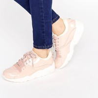 Puma | Puma R698 Trainers In Patent Nude at ASOS