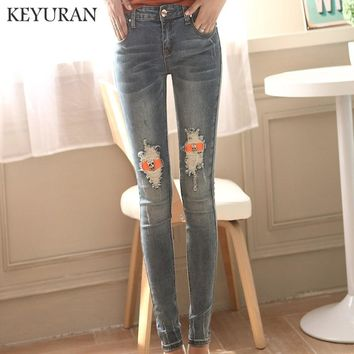 Women Skull Jeans Elastic Women's Denim Jeans washed casual skinny pencil pants