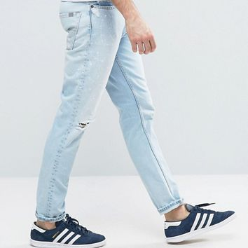 Calvin Klein Jeans Vintage Splatter Light Wash Jeans In Slim Fit at asos.com