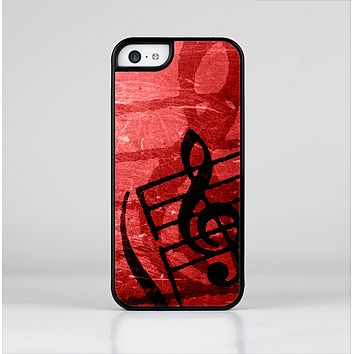 The Scratched Red Surface with Black Music Note Skin-Sert Case for the Apple iPhone 5c