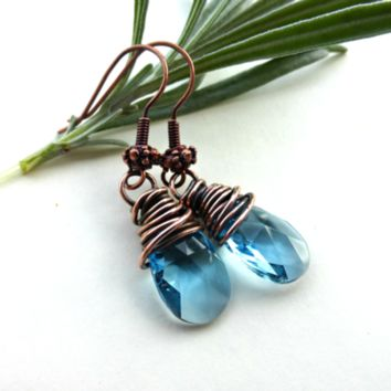 Aquamarine blue Swarovski crystal and copper wire wrapped earrings. Small size earrings.