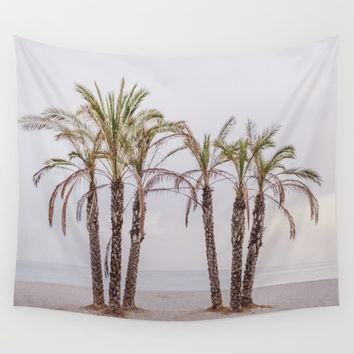 Palms. Sunset at the beach Wall Tapestry by Guido Montañés