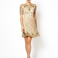 Frock and Frill Embellished Skater Dress with Open Back