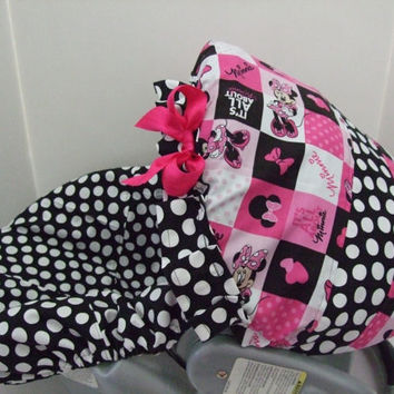 Adorable cotton Minnie Mouse print infant car seat slip cover set with coordinated canopy.