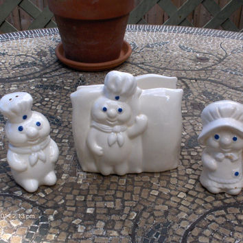 Price Reduction - Pillsbury Company Dough Boy/Girl Salt and Pepper Shakers and Napkin Holder - 1988