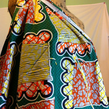 African Wax Print Fabric by the HALF YARD.  Spools of thread in green, yellow, white and orange.