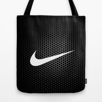 nikee Tote Bag by Max Jones | Society6