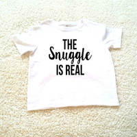 The snuggle is real graphic children's Tshirt. Sizes 2T, 3t, 4t, 5/6T