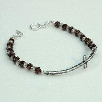 Bracelet with Sterling Silver cross, copper beads and silver toggle clasp.