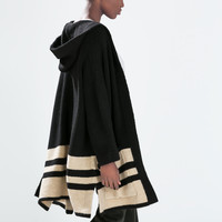 Hooded poncho with striped hem
