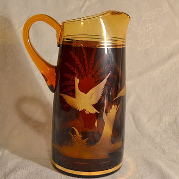 Amber Glass Pitcher Wheel Etched Engraved Game Birds Tree  Cattails Flashed Root Beer Color Gold Trim Blown Glass Applied Handle