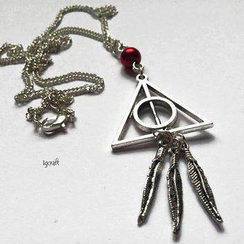 Harry Potter silver tone Deathly Hallows necklace with feathers invisibility cloak, resurrection stone, elder wand