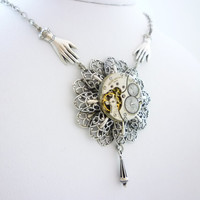 SteamPunk Neo-VictorianNecklace with Helping Hand and Vintage Watch Movement on Double Filigree Pendant by VictorianFolly
