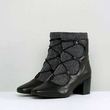 4b3f06dbfcc8 Sol Sana Cupid Black Leather Glitter Ghillie Boots at asos.com