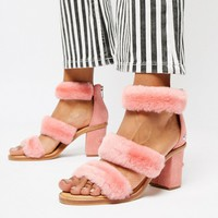 UGG Excluisve Del Rey Pink Triple Strap Fluffy Heeled Sandals at asos.com