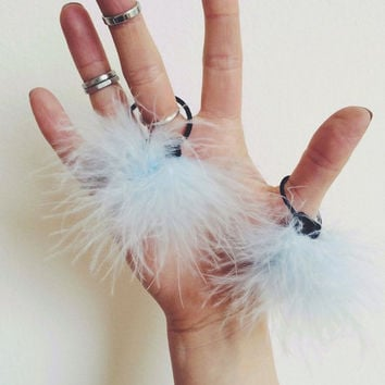 Fluffy pom pom hair ties. Two stretch hair ties with fluff pom pom details.