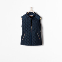 Zipped quilted vest