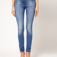 ASOS Supersoft High Waisted Ultra Skinny Jeans in Light Wash at asos.com