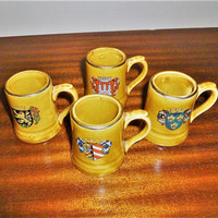 Vintage 1960s set of Four (4) Miniature German Beer Steins Showing Family Shields / Crests - Made 0f Ceramic /  Made in Japan