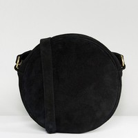 Reclaimed Vintage Inspired Suede Round Cross Body Bag at asos.com