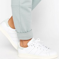 adidas Originals White Stan Smith Sneakers With Silver Metallic Detail at asos.com