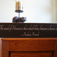 The wind of Heaven is that which blows between a horse's ear, Arabian Proverb wood sign