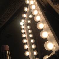 White Space Saver lighted wall vanity mirror. Bottom of the frame is made with NO light bulbs, giving you more space to get ready with!