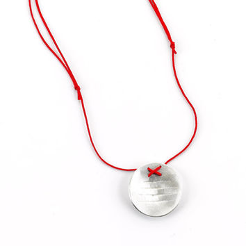 DOKU silver round shaped hand-made designers pendant with texture.
