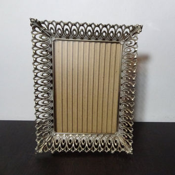 Vintage 5 x 7 Brass or Gold Tone Metal Filigree Footed Dimensional Picture Frame with Lightly Antiqued Linked Oval Design