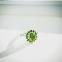 STS Green Oval Cabochon Gemstone with Gold Striations Ring surrounded by halo of free and clear stones set in Sterling Silver