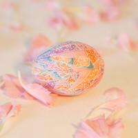 Chiyogami washi egg, Japanese decoupage, handmade décor - pink embossed with colorful ribbons of plum blossom, chrysanthemum, and peony
