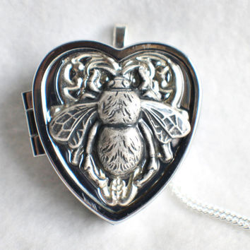 Music box locket,  heart shaped locket with music box inside, in silver with a bumble bee on front cover