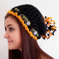 crochet Steelers girl inspired hat. with pom pom. Made by Bead Gs on Etsy. Black and gold. Ladies size.
