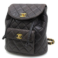 Vintage CHANEL quilted black, darkbrown lamb leather backpack with gold chain and CC closure. Classic  and most popular purse