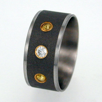 Titanium Ring set with Diamond and Sapphires - The stones are flush set in Gold