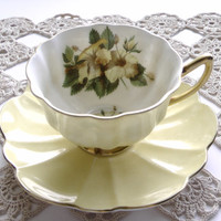 Shelley England tea cup and saucer set in pastel yellow shaped lika a flower.