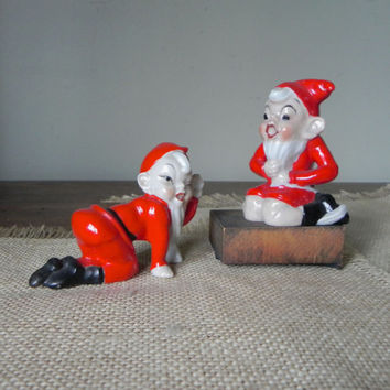 Vintage two Christmas elves elf pixie with beards crawling and pulling his beard